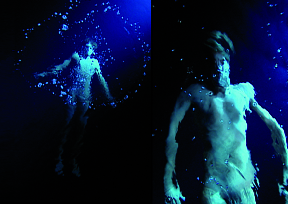 Bill Viola, The Messenger, 1996. Video and sound installation. Colour video on vertical wall screen in darkened room.*